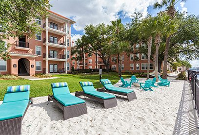 Bell Riverside apartments lounge chairs in sand